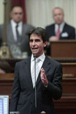 State Senate Budget Committee chairman Mark Leno, center, urges lawmakers to approve the 2012-13 state budget at the state Capitol in Sacramento, Calif., Friday, June 15, 2012. The Senate approved the budget plan by a 23-16 vote. The budget was later approved by the Assembly, 50-25 and sent to the governor. (AP Photo/Rich Pedroncelli) Photo: Rich Pedroncelli, Associated Press