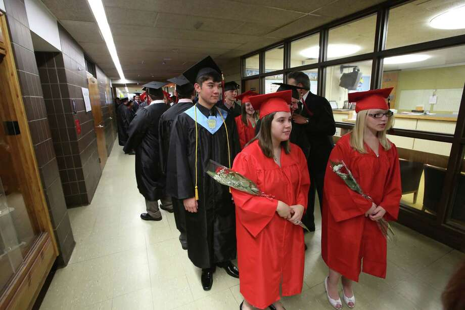 Mike Ross Connecticut Post freelance - Platt Technical High School seniors make their way down hallway during Friday's commence exercises. Photo: Mike Ross / Connecticut Post Freelance
