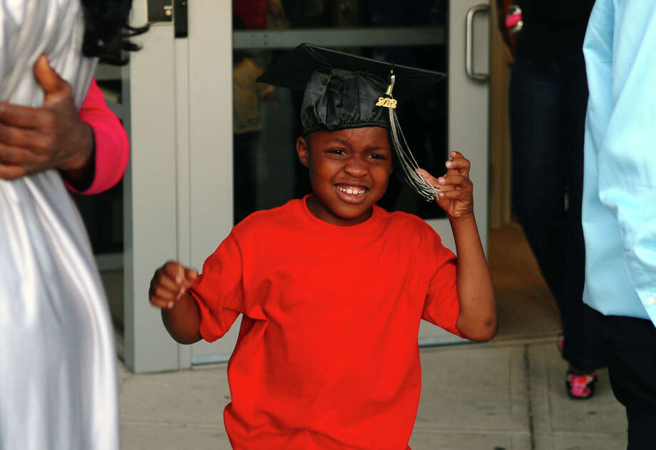 Amari Geer, 6, wears his brother Kimani's cap after Bridge Academy's Class of 2012 Commencement Exercises in Bridgeport, Conn. on Friday June 15, 2012. Photo: Christian Abraham / Connecticut Post