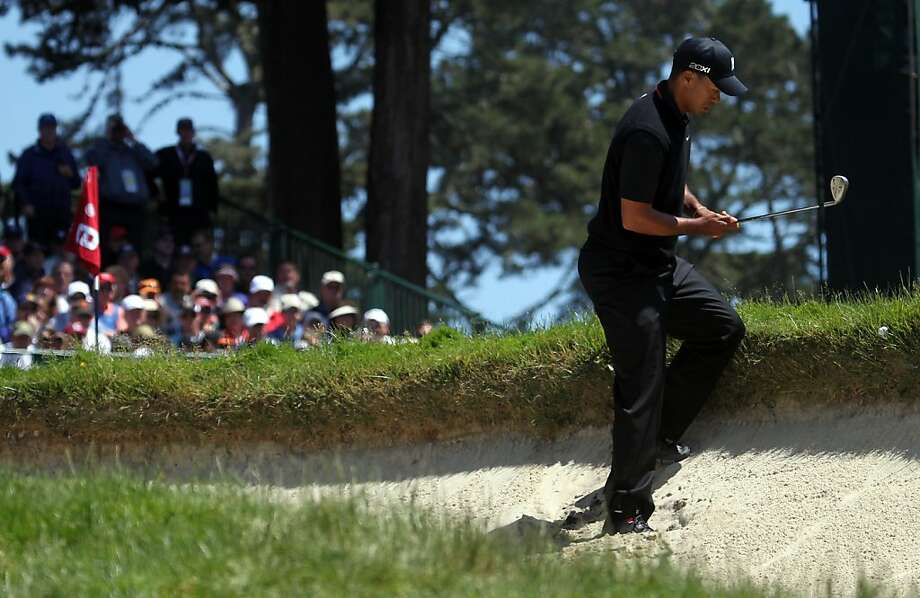 Tiger Woods works with a difficult situation after his ball landed next to the bunker on the sixth hole during the second round of the 112th U.S. Open at The Olympic Club on Friday June 15, 2012 in Daly City, California. Photo: Lance Iversen, The Chronicle