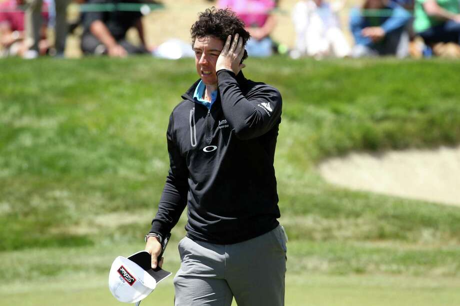 SAN FRANCISCO, CA - JUNE 15:  Rory McIlroy of Northern Ireland walks off the eighth green during the second round of the 112th U.S. Open at The Olympic Club on June 15, 2012 in San Francisco, California.  (Photo by Andrew Redington/Getty Images) Photo: Andrew Redington