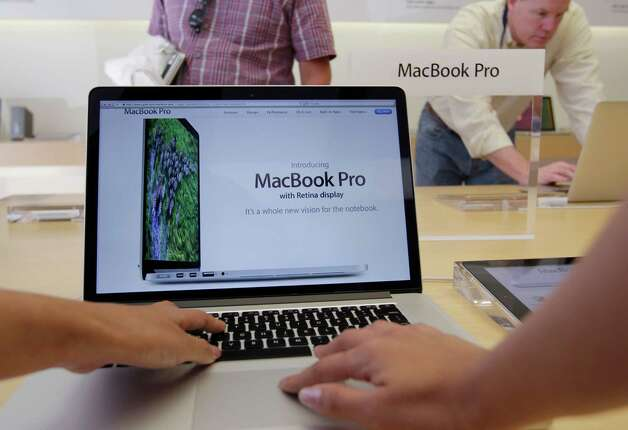 The new MacBook Pro with retina display, photographed at an Apple store in Palo Alto, Calif.,  has 2.5 times more pixels than a high-definition television set. Photo: Paul Sakuma / AP