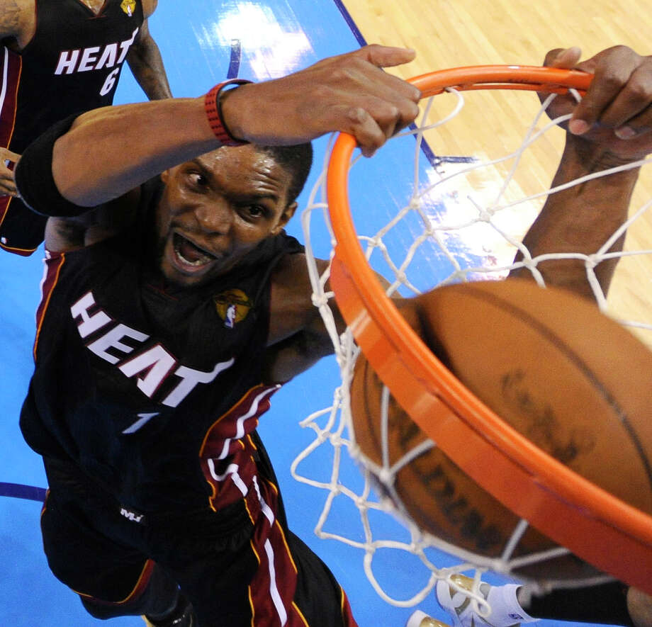 Miami Heat power forward Chris Bosh  dunks against the Oklahoma City Thunder during the second half at Game 2 of the NBA finals basketball series, Thursday, June 14, 2012, in Oklahoma City. The Heat won 100-96. (AP Photo/Larry W. Smith, Pool) Photo: Larry W. Smith