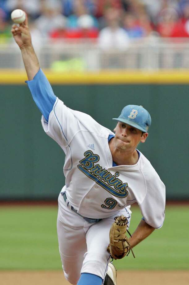 UCLA's starting pitcher Adam Plutko works against Stony Brook in the first inning of an NCAA College World Series baseball game in Omaha, Neb., Friday, June 15, 2012. (AP Photo/Nati Harnik) Photo: Nati Harnik