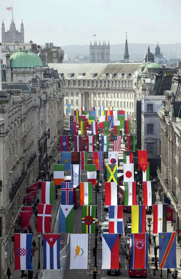 A view of Regent Street in London flying flags from around the globe as it welcomes the world to celebrate the London 2012 games, London, Friday, June 15, 2012. (AP Photo/John Phillips/PA) UNITED KINGDOM OUT NO SALES NO ARCHIVE Photo: John Phillips