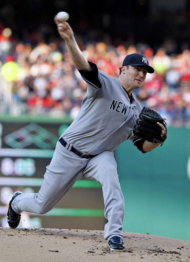 New York Yankees starting pitcher Phil Hughes throws during the first inning of a baseball game against the Washington Nationals  at Nationals Park on Friday, June 15, 2012, in Washington.(AP Photo/Alex Brandon) Photo: Alex Brandon