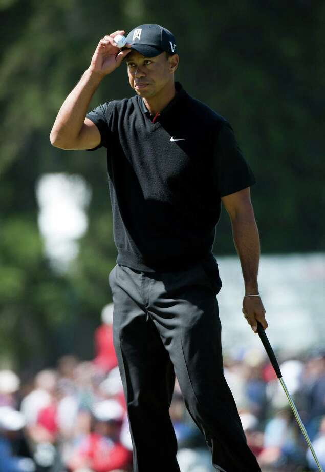 A tip of the cap goes to Tiger Woods for surviving three straight front-nine bogeys and grinding out an even-par 70. Photo: Paul Kitagaki Jr. / Sacramento Bee