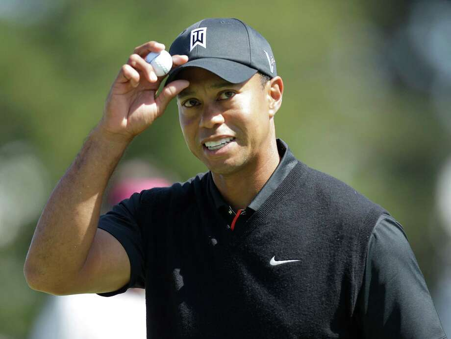 Tiger Woods reacts after making a birdie on the 10th hole during the second round of the U.S. Open Championship golf tournament Friday, June 15, 2012, at The Olympic Club in San Francisco. (AP Photo/Ben Margot) Photo: Ben Margot