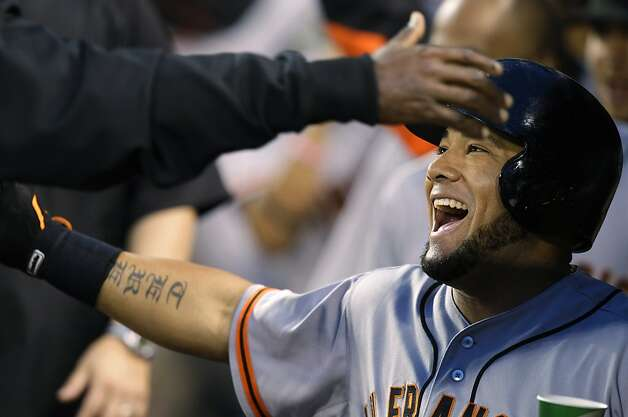 San Francisco Giants' Melky Cabrera is greeted in the dugout after he hit a two-run home run against the Seattle Mariners in the eighth inning of a baseball game, Friday, June 15, 2012, in Seattle. (AP Photo/Ted S. Warren) Photo: Ted S. Warren, Associated Press