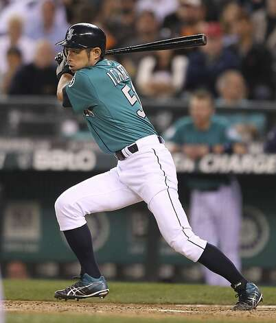 SEATTLE, WA - JUNE 15:  Ichiro Suzuki #51 of the Seattle Mariners hits into an RBI fielders choice in the eighth inning against the San Francisco Giants at Safeco Field on June 15, 2012 in Seattle, Washington. (Photo by Otto Greule Jr/Getty Images) Photo: Otto Greule Jr, Getty Images