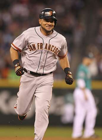SEATTLE, WA - JUNE 15:  Melky Cabrera #53 of the San Francisco Giants rounds the bases on a two-run home run against the Seattle Mariners at Safeco Field on June 15, 2012 in Seattle, Washington. (Photo by Otto Greule Jr/Getty Images) Photo: Otto Greule Jr, Getty Images