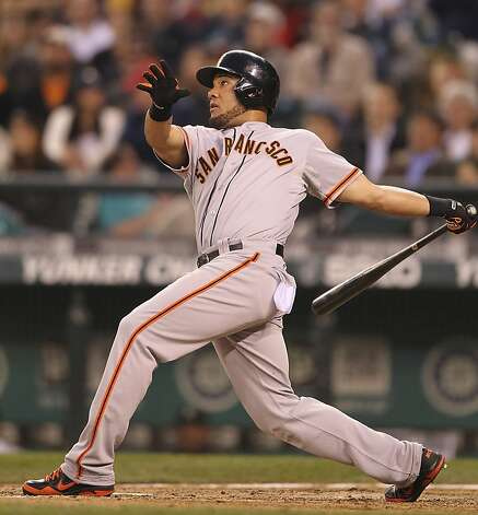 SEATTLE, WA - JUNE 15:  Melky Cabrera #53 of the San Francisco Giants hits a two-run home run against the Seattle Mariners at Safeco Field on June 15, 2012 in Seattle, Washington. (Photo by Otto Greule Jr/Getty Images) Photo: Otto Greule Jr, Getty Images