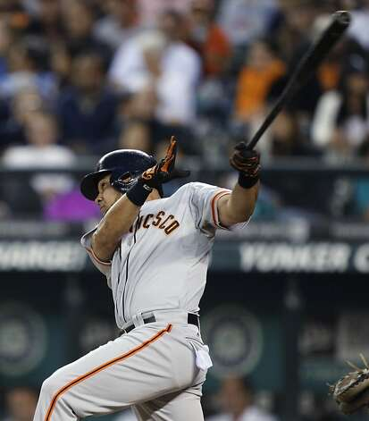 San Francisco Giants' Melky Cabrera follows through on a two-run home run against the Seattle Mariners in the eighth inning of a baseball game, Friday, June 15, 2012, in Seattle. (AP Photo/Ted S. Warren) Photo: Ted S. Warren, Associated Press