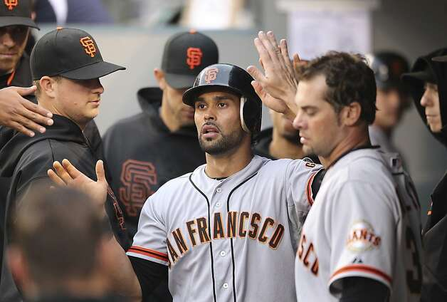 SEATTLE, WA - JUNE 15:  Angel Pagan #16 of the San Francisco Giants is congratulated by teammates after scoring on a sacrifice fly by Joaquin Arias against the Seattle Mariners at Safeco Field on June 15, 2012 in Seattle, Washington. (Photo by Otto Greule Jr/Getty Images) Photo: Otto Greule Jr, Getty Images