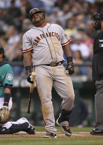SEATTLE, WA - JUNE 15:  Pablo Sandoval #48 of the San Francisco Giants reacts after swinging and missing against the Seattle Mariners at Safeco Field on June 15, 2012 in Seattle, Washington. (Photo by Otto Greule Jr/Getty Images) Photo: Otto Greule Jr, Getty Images