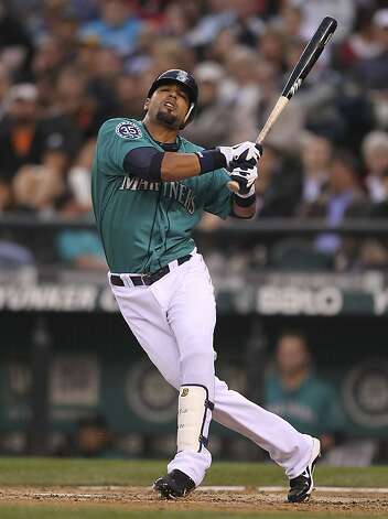 SEATTLE, WA - JUNE 15:  Franklin Gutierrez #21 of the Seattle Mariners twists on an awkward swing against the San Francisco Giants at Safeco Field on June 15, 2012 in Seattle, Washington. (Photo by Otto Greule Jr/Getty Images) Photo: Otto Greule Jr, Getty Images