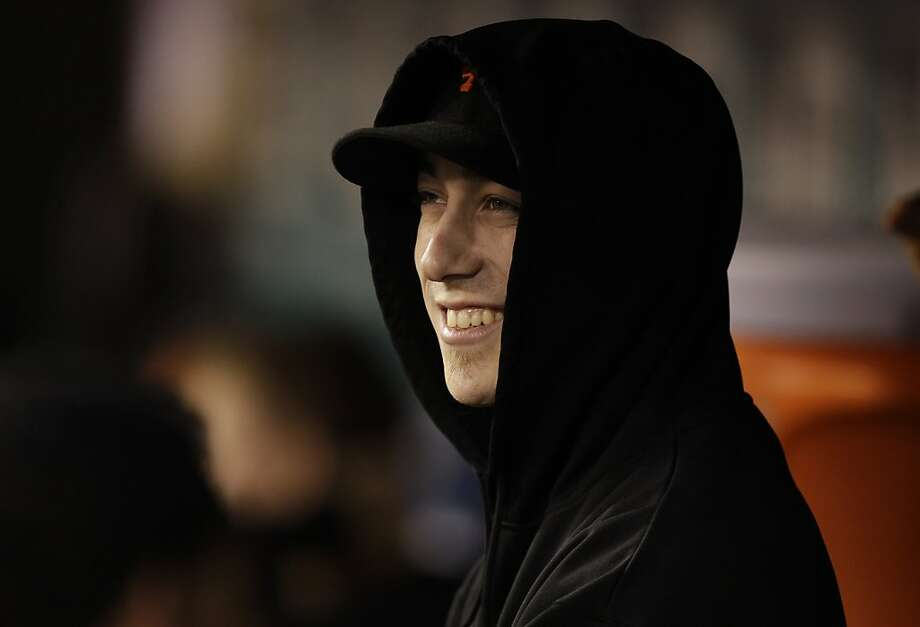 San Francisco Giants pitcher Tim Lincecum smiles as he watches from the dugout during the Giants' baseball game against the Seattle Mariners, Friday, June 15, 2012, in Seattle. Six years after the Mariners bypassed Lincecum in the first round of the draft, Lincecum finally will make it to the Safeco Field mound on Saturday night for the second game of the series. (AP Photo/Ted S. Warren) Photo: Ted S. Warren, Associated Press