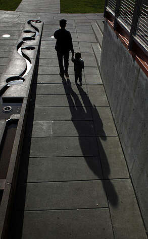 Jason Chandler (l to r) and his son, Johnny Chandler, 3, cast long shadows as they leave the playground at Yerba Buena Gardens on Wednesday, January 12, 2011 in San Francisco, Calif. Photo: Lea Suzuki, The Chronicle