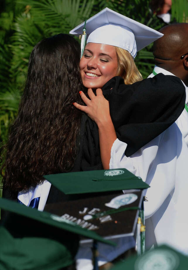 Graduate Samantha Chieffalo hugs her guidance counsler Chelsey Docimo after getting her diploma, during Norwalk High School's Class of 2012 Commencement Ceremony in Norwalk, Conn. on Friday June 15, 2012. Photo: Christian Abraham / Connecticut Post