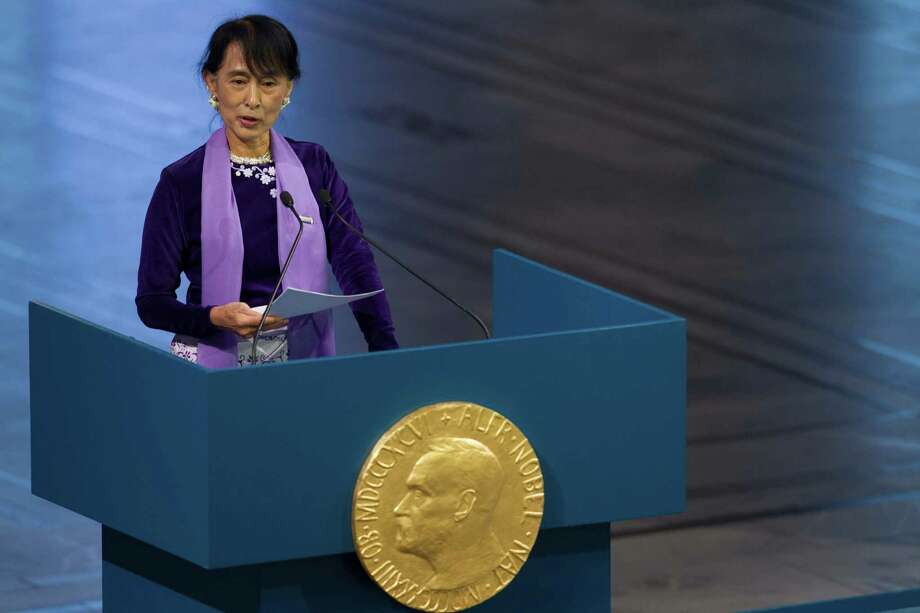 Myanmar opposition leader Aung San Suu Kyi, holds her speech during the Peace Nobel Prize lecture at the city hall in Oslo, Saturday, June 16, 2012. Burmese opposition leader Aung San Suu Kyi Nobel peace prize laureate, formally accepts the prize that thrust her into the global limelight two decades ago. Suu Kyi says the Nobel Peace Prize she won while under house arrest 21-years ago helped to shatter her sense of isolation and ensured that the world would demand democracy in her military-controlled homeland. Photo: Markus Schreiber, Associated Press