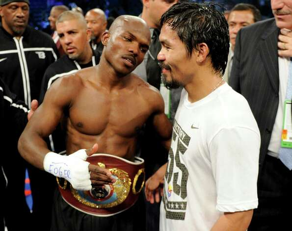 Timothy Bradley talks with Manny Pacquiao after the controversial end to their WBO welterweight title fight last weekend. Photo: AP