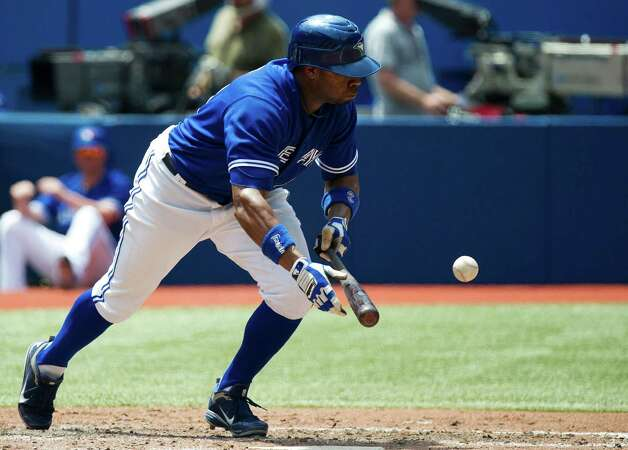 Toronto Blue Jays left fielder Rajai Davis attempts to bunt against the Philadelphia Phillies during the third inning of an interleague baseball game in Toronto on Saturday, June 16, 2012. (AP Photo/The Canadian Press, Nathan Denette) Photo: Nathan Denette