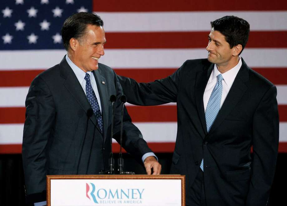 Rep. Paul Ryan (right), R-Wis., introduces Mitt Romney during an April campaign speech in Milwaukee. Photo: M. Spencer Green, AP