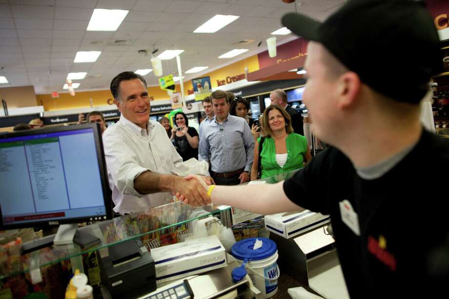 Republican presidential candidate, former Massachusetts Gov. Mitt Romney shakes hands during a stop at Wawa gas station in  in Quakertown, Pa., Saturday, June 16, 2012. Photo: AP