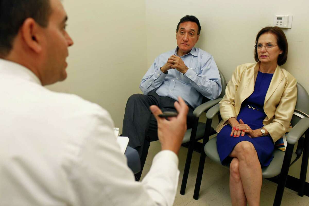 Dr. Michael A. Selva, left, a radiation oncologist, answers questions from Henry Cisneros and his wife, Mary Alice Cisneros, before his daily radiation treatment at San Antonio Center for Cancer Treatment on Tuesday, June 12, 2012. Cisneros meets with his doctor once a week during the treatment.
