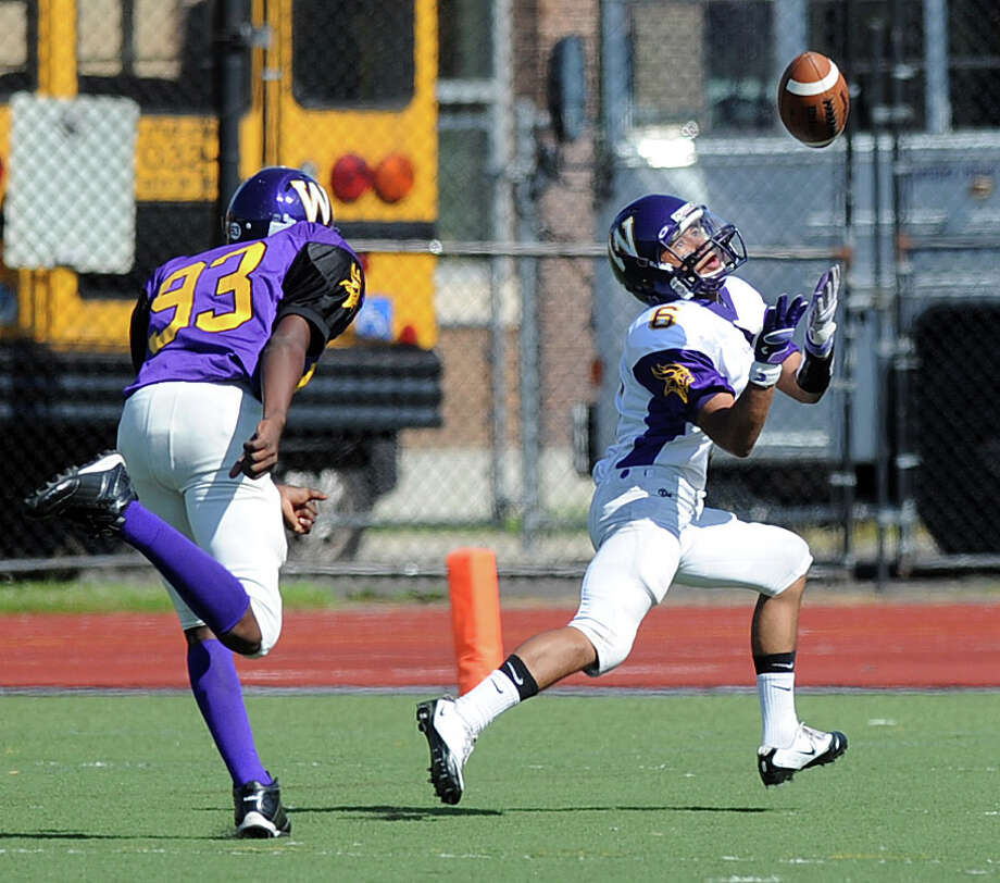 Sean Remondino makes a catch for a touchdown during Saturday's spring football game at Westhill High School on June 16, 2012. Photo: Lindsay Niegelberg / Stamford Advocate