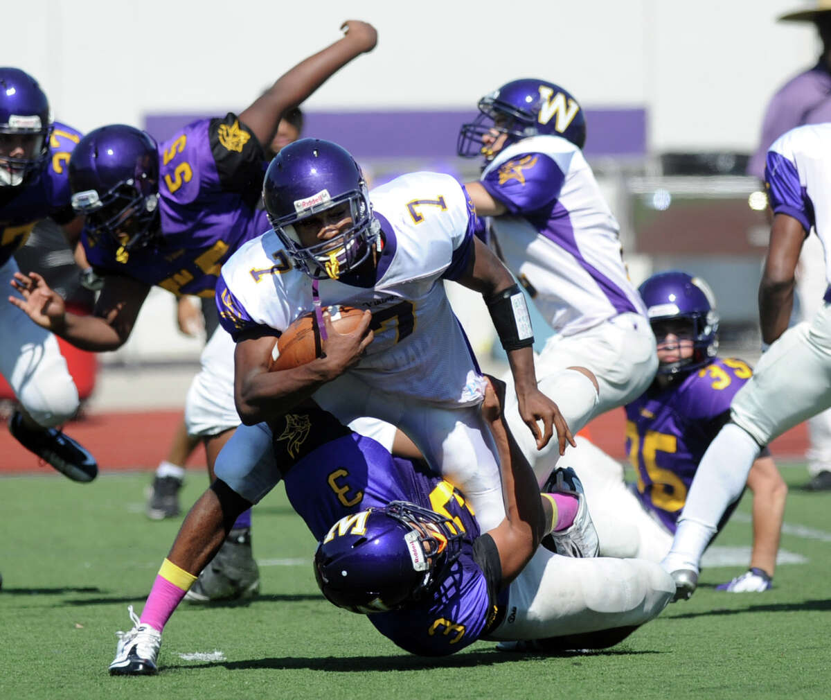 Davell Cotterell carries the ball during Saturday's spring football game at Westhill High School on June 16, 2012.