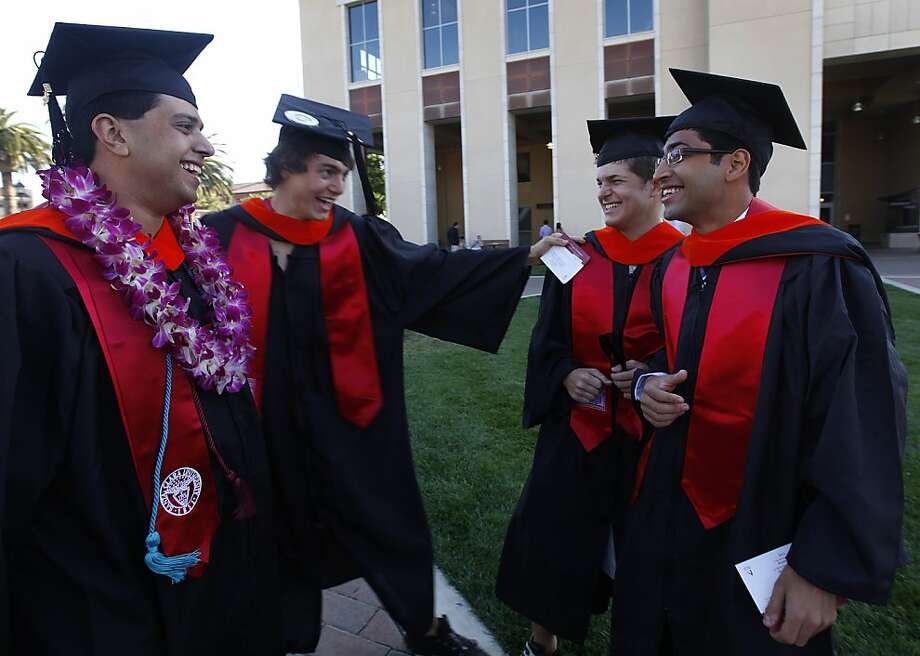 Graduating engineering students (L to R) Sutyen Zalawada, Mike Sizemore, Ross Pimentel and Sandeep Lele share a light moment before commencement exercises for Santa Clara University students in Santa Clara, Calif. on Saturday, June 16, 2012. The group is continuing the research in alternative energy that their associate professor, Dan Strickland, was working on before he died in an auto accident last year. Photo: Paul Chinn, The Chronicle