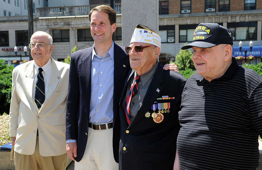Congressman Jim Himes poses for a photo with veterans Peter Weinberg, far left, Peter Gregory, far right, and Gergory's father, Joe, second from right. Himes presented medals to veterans Peter Weinberg and Peter Gregory at Veterans Park in Stamford on Saturday, June 16, 2012. The medals were awarded to the veterans when they served in World War II and Korea, respectively, but were not given to them until Saturday. Photo: Lindsay Niegelberg / Stamford Advocate