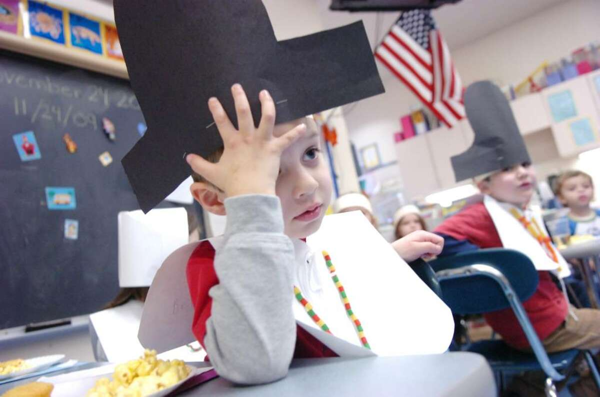 Benjamin Cooper rests during the Thanksgiving feast the Cos Cob School kindergarten classes shared at the school Tuesday, Nov. 24, 2009.