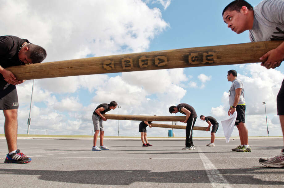 "A group of ""Future Soldiers,"" residents that have recently enlisted in the military, do log drills for muscle building as friends and local members of the U.S. Army gathered at the Harlingen, Texas Soccer Complex on Saturday, June 16, 2012. Photo: AP"