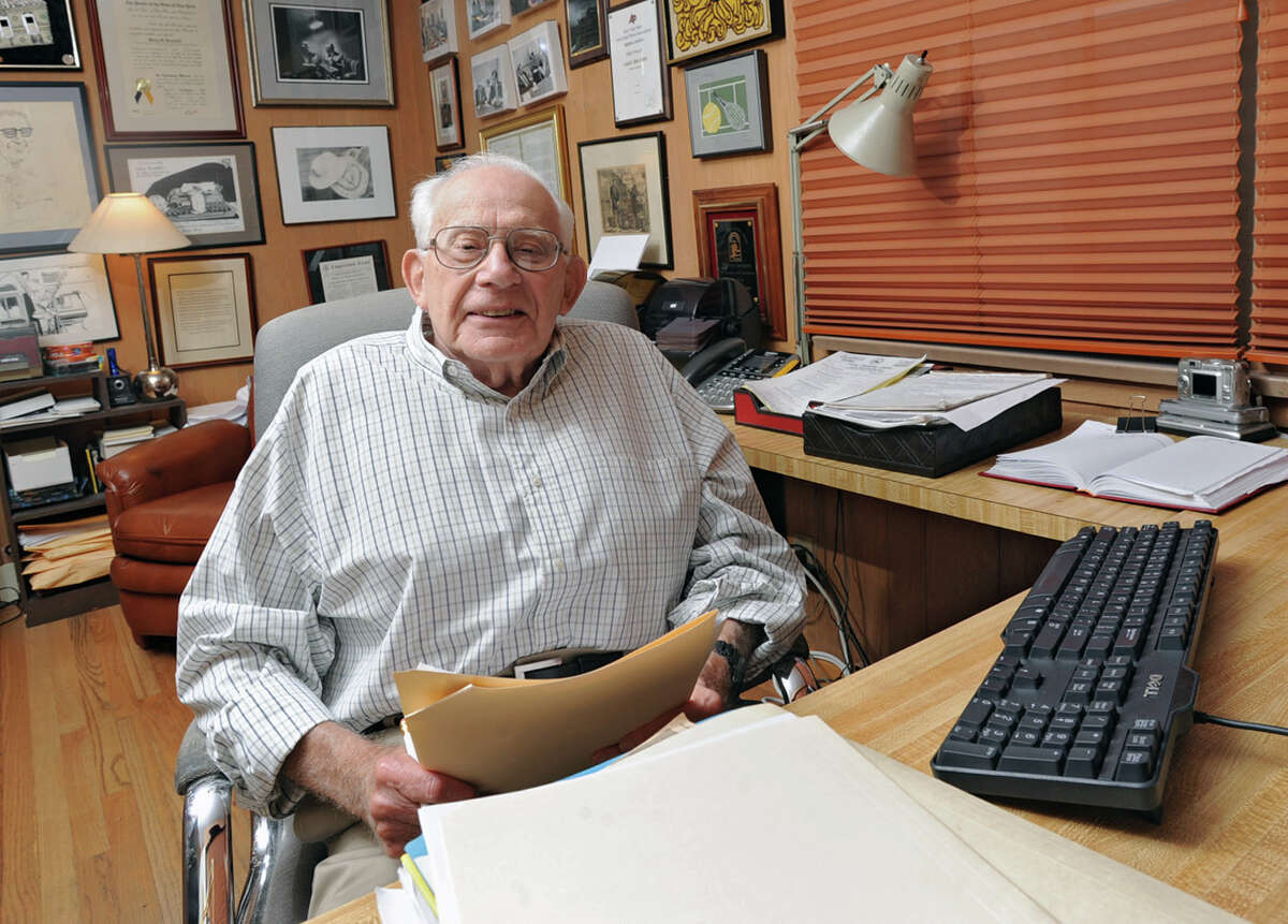 Times Union editor-at-large Harry Rosenfeld sits at desk where he writes at his home on June 13, 2012 in Albany, N.Y. It's the 40th anniversary of Watergate and he reminiscences directing Woodward & Bernstein's coverage at The Washington Post .(Lori Van Buren / Times Union)