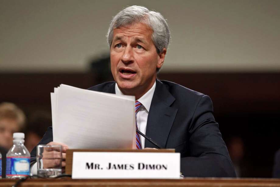 JPMorgan Chase CEO Jamie Dimon, head of the largest bank in the United States, testifies on Capitol Hill in Washington, Wednesday, June 13, 2012, before the Senate Banking Committee about how his company recently lost more than $2 billion on risky trades. (AP Photo/J. Scott Applewhite) Photo: J. Scott Applewhite