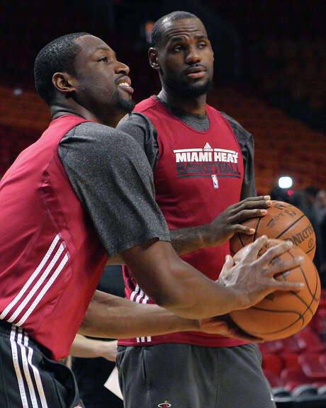 Dwyane Wade (left), practicing with teammate LeBron James on Saturday, said it's imperative for Miami to win tonight's Game 3, Photo: AP