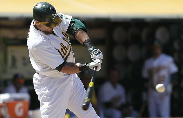 Oakland Athletics' Jonny Gomes hits a two-run home run off San Diego Padres pitcher Luke Gregerson during the seventh inning of a baseball game in Oakland, Calif., Saturday, June 16, 2012. (AP Photo/Jeff Chiu) Photo: Jeff Chiu, Associated Press