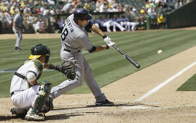 San Diego Padres' Carlos Quentin (18) hits a two-run home run off Oakland Athletics pitcher Tyson Ross during the sixth inning of a baseball game in Oakland, Calif., Saturday, June 16, 2012. At left is Athletics catcher Kurt Suzuki. (AP Photo/Jeff Chiu) Photo: Jeff Chiu, Associated Press