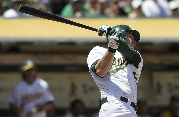 Oakland Athletics' Seth Smith watches his solo home run off San Diego Padres pitcher Ross Ohlendorf during the fourth inning of a baseball game in Oakland, Calif., Saturday, June 16, 2012. (AP Photo/Jeff Chiu) Photo: Jeff Chiu, Associated Press