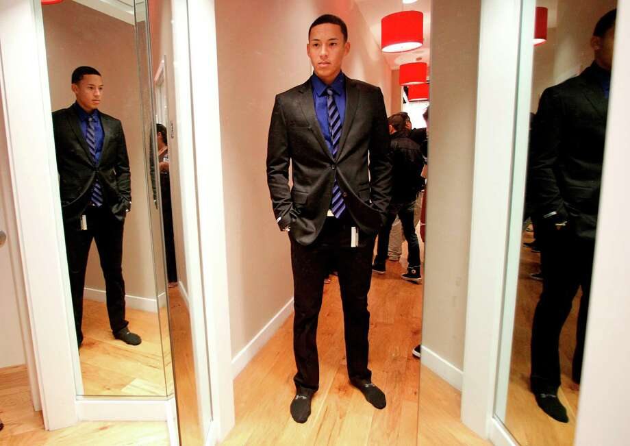 Carlos Correa looks at his reflection in the fitting room of retail store Express as he shops for his graduation suit at Plaza Las Americas, the largest mall in the Caribbean, on Saturday, June 9, 2012, in San Juan. Photo: Mayra Beltran, Houston Chronicle / © 2012 Houston Chronicle