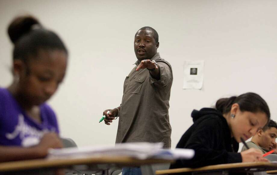 Texas Southern University professor Brian Mack teaches an English class in a summer credit program designed to help bridge the learning gap between high school and college-level courses. Photo: J. Patric Schneider / Houston Chronicle