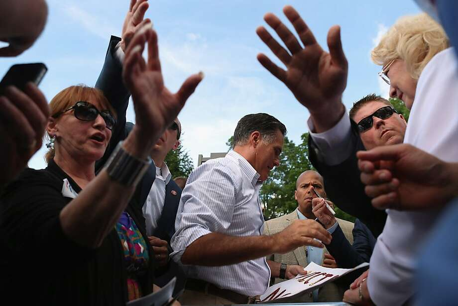 CORNWALL, PA- JUNE 16:   Republican presidential candidate, former Massachusetts Governor Mitt Romney prepares to autograph a sign as he shakes hands with people during a campaign event at the Cornwall Iron Furnace on June 16, 2012 in Cornwall, Pennsylvania.  Mr. Romney continues hs campaign swing through battle ground states as he competes with President Barack Obama for votes.  (Photo by Joe Raedle/Getty Images) Photo: Joe Raedle, Getty Images
