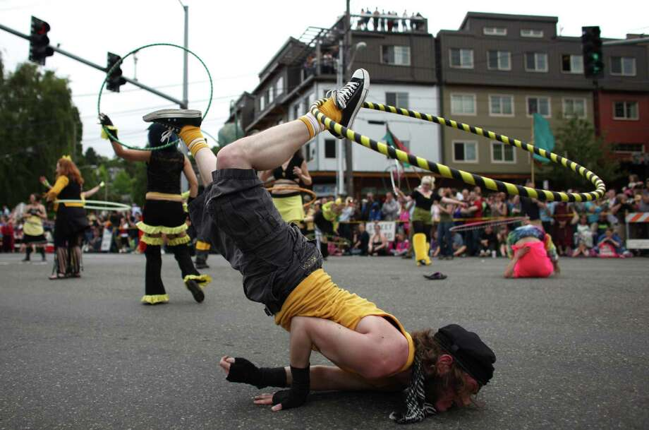 Taylor Daynes twirls a hula hoop on his foot during the Fremont Solstice Parade in Seattle on Saturday, June 16, 2012. Thousands came out for the annual event that acts as a kickoff to summer in Seattle. Photo: JOSHUA TRUJILLO / SEATTLEPI.COM
