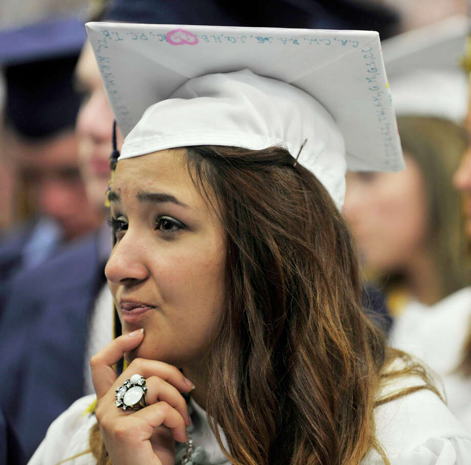 Jennifer Acosta listens to the speakers during the Brookfield High School graduation in the O'Neill Center at Western Connecticut State University's westside campus in Danbury on Saturday, June 16, 2012. Photo: Jason Rearick / The News-Times