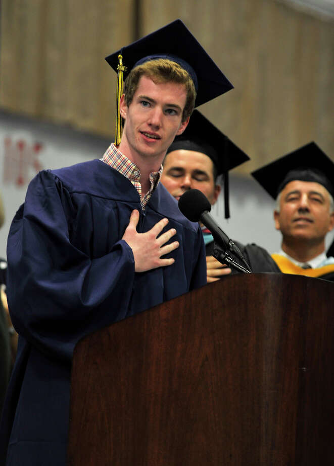 Student Council President James Dunn leads the saying of the Pledge of Allegiance during the Brookfield High School graduation in the O'Neill Center at Western Connecticut State University's westside campus in Danbury on Saturday, June 16, 2012. Photo: Jason Rearick / The News-Times