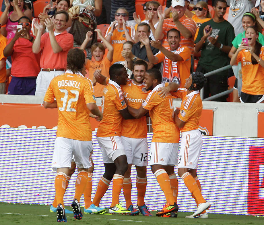 The Houston Dynamo forward Will Bruin center, celebrates with teammates after scoring a goal against FC Dallas during the first half of MLS game action at BBVA Compass Stadium Saturday, June 16, 2012, in Houston. Photo: James Nielsen, Chronicle / © Houston Chronicle 2012