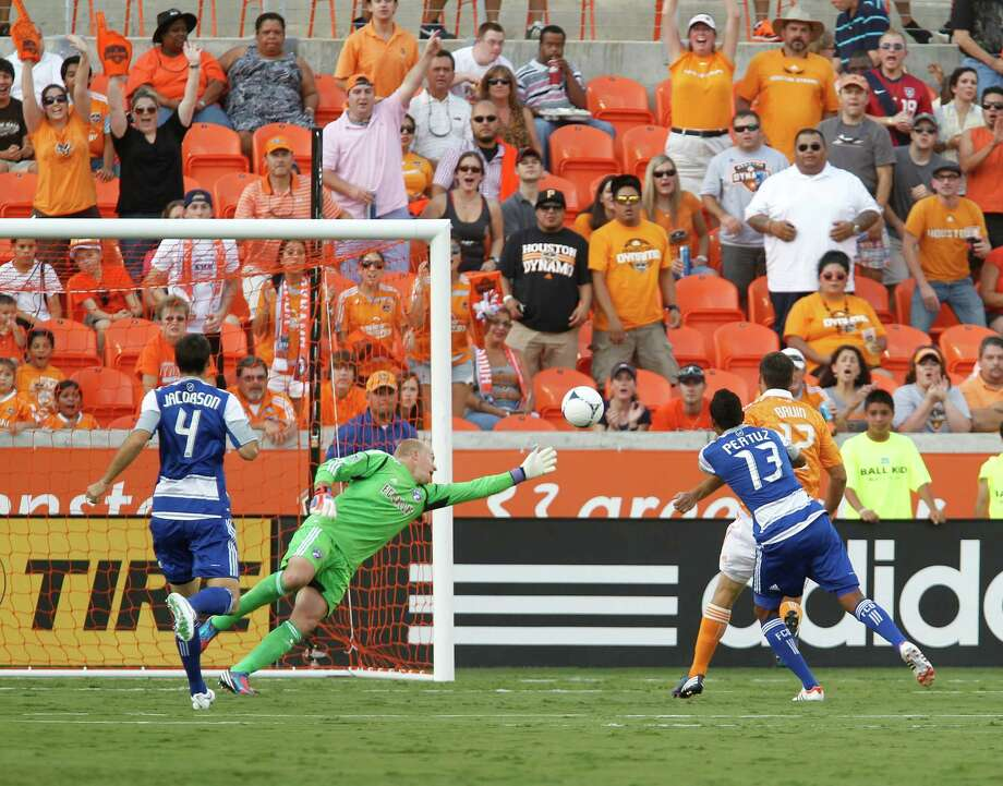 The FC Dallas goalkeeper Kevin Hartman 2nd from left, misses blocking a shot for a goal by the Houston Dynamo forward Will Bruin right, during the first half of MLS game action at BBVA Compass Stadium Saturday, June 16, 2012, in Houston. Photo: James Nielsen, Chronicle / © Houston Chronicle 2012
