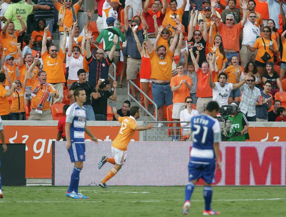 The Houston Dynamo forward Will Bruin center, celebrates after scoring a goal against FC Dallas during the first half of MLS game action at BBVA Compass Stadium Saturday, June 16, 2012, in Houston. Photo: James Nielsen, Chronicle / © Houston Chronicle 2012